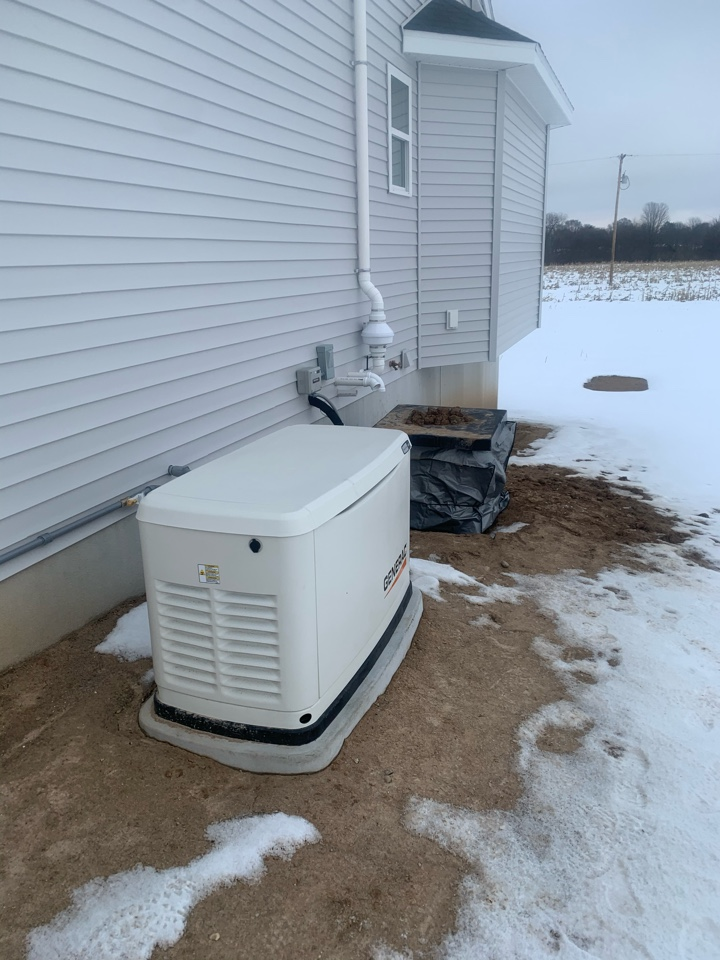 Sand Lake, MI - Nice location for this exterior radon mitigation system on this house.