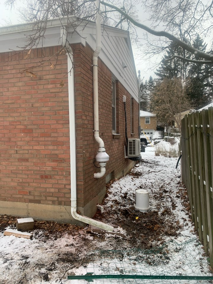 Grand Rapids, MI - Nice location for this exterior radon mitigation system on this house.