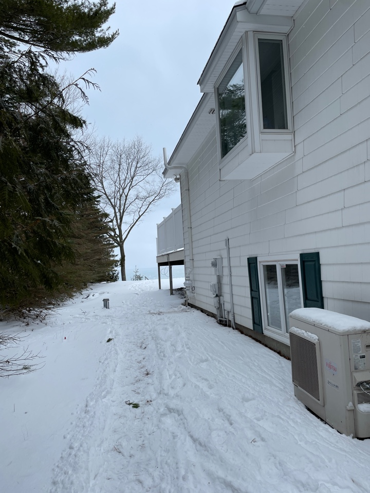 Manistee, MI - This job was all the way up in Manistee. Thankfully our location for the system worked out. The homeowners were worried about seeing the system from their back deck. Taking that into account we were able to keep it out of sight and out of mind.