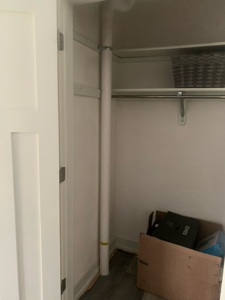 Caledonia, MI - This radon mitigation system was installed in this house through a closet near the kitchen. There was no other options available to route the radon system but the job turned out good and the system is hidden.