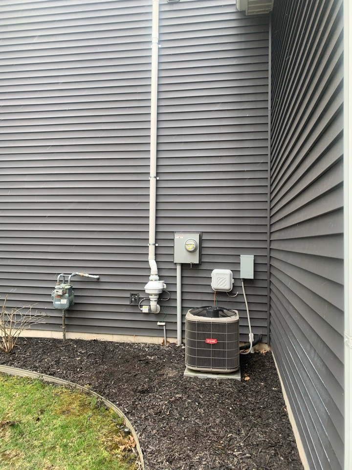 Hudsonville, MI - This exterior radon mitigation system was installed this morning on a house in Hudsonville. This location worked well because the system is hidden behind the garage.