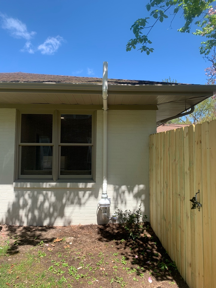 Grand Rapids, MI - For this house we had to route the radon mitigation system across a 30 ft crawl space to the back corner of the house. This location was the best option for this house and kept the system hidden from the front of the home.