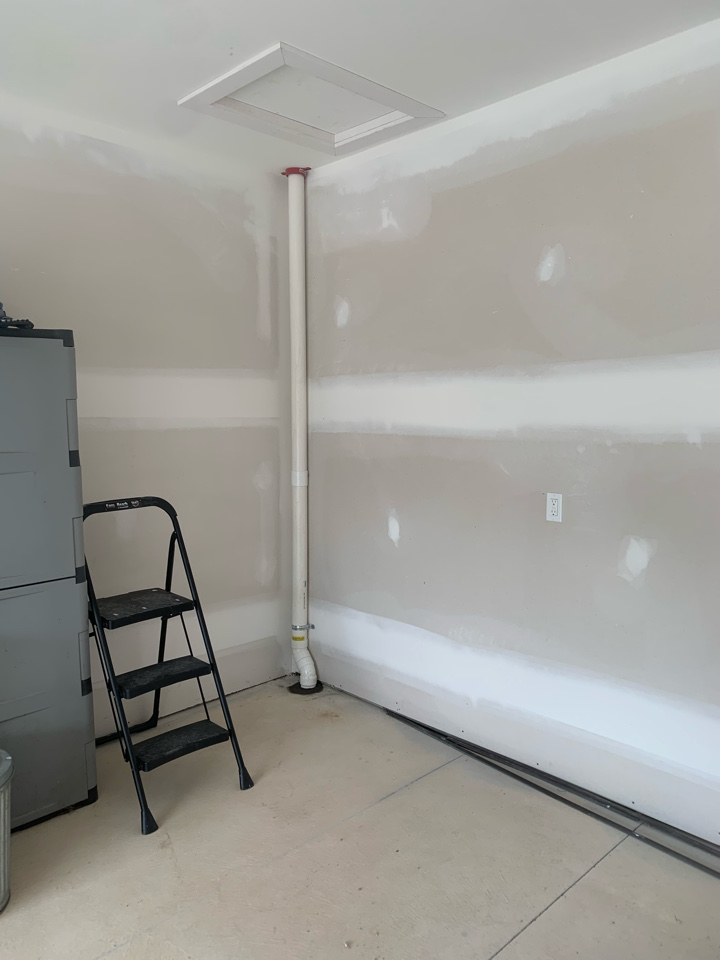 Lowell, MI - This is all our customers will see of their new radon mitigation system. This was a good job but we had to hire a concrete cutter to make our first hole to get the pipe into the basement. This condo is built for easy living and has no steps into the living area from the garage and is why we had to cut through concrete so that our system didn't have to be on the exterior of the property.