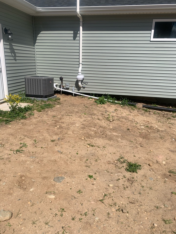 Lowell, MI - Another exterior radon mitigation system installed on this new house built by Sable Homes.
