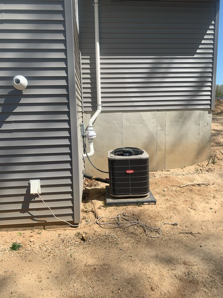 Lowell, MI - Today we installed an exterior radon mitigation system on this new house. This system was able to be routed behind the bump out of the garage making the radon fan hidden from view.