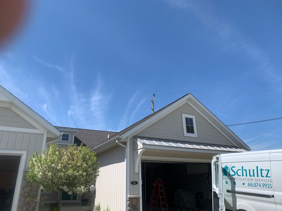Zeeland, MI - The vent stack going through the roof is all you see of this radon mitigation system.