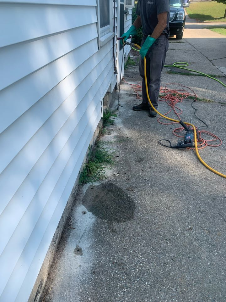 Grand Rapids, MI - Treating a house for termites this morning. Our pest control services stop termites immediately and prevent them from ever coming back.