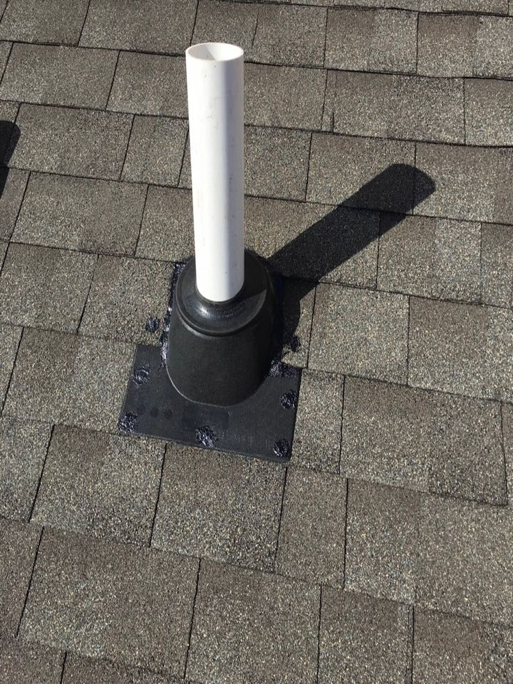 Georgetown Township, MI - This is what our radon mitigation system exhaust pipe looks like, we install our own roof flashing and use a stencil to make sure it looks as clean and professional as possible.