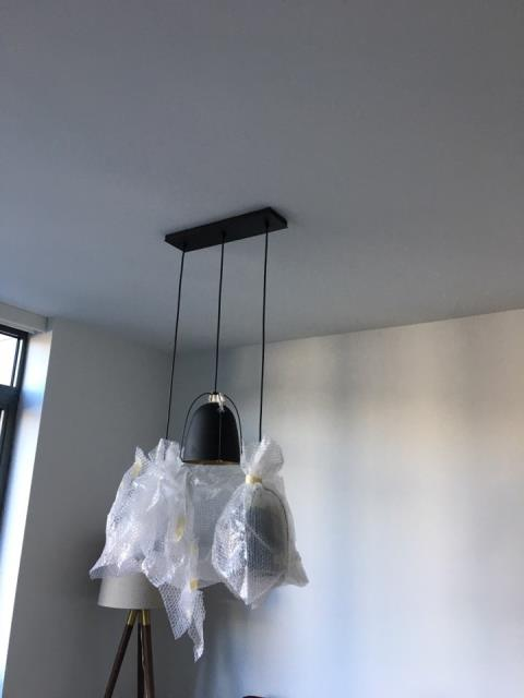 Installed rectangular pendant light - These hanging fixtures add brightness and style to any room in the house.
