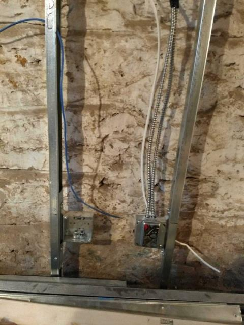 Installing electrical wiring throughout basement