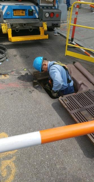Con Edison Snaking through Manhole