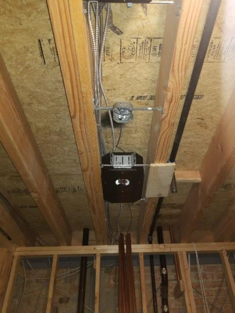 Running cable and mounted boxes for smoke detectors/ security system.