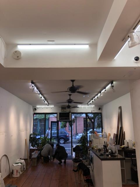 New installation of track lighting for clothing boutique in Manhattan