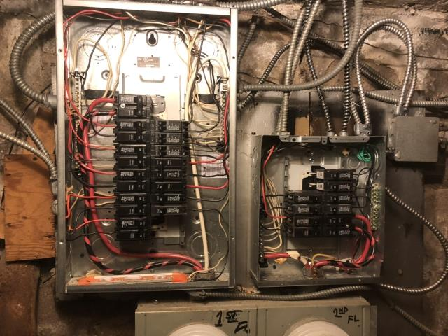 Replaced two 100 amp main breaker panels due to home inspection requirements