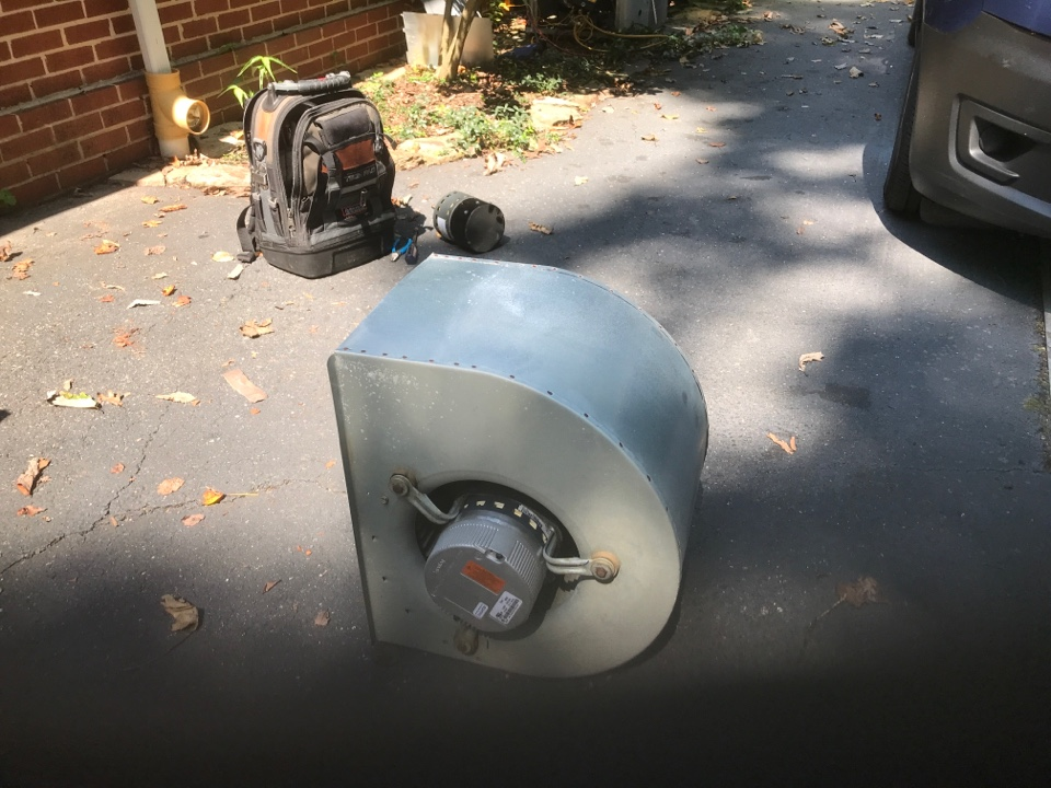 Tech replaced bad blower motor in the  21 Year old Carrier Air handler in attic. The AC works now,