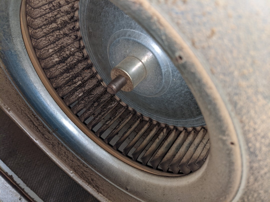 Tech arrived for maintenance and found dirty blower wheel.