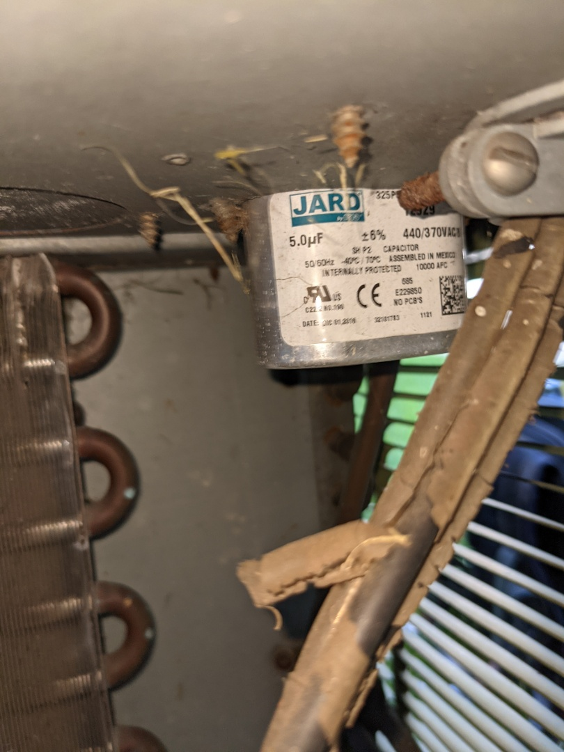 Charlie checked all electrical and mechanical components for a 10 year old AC during a service maintenance call.