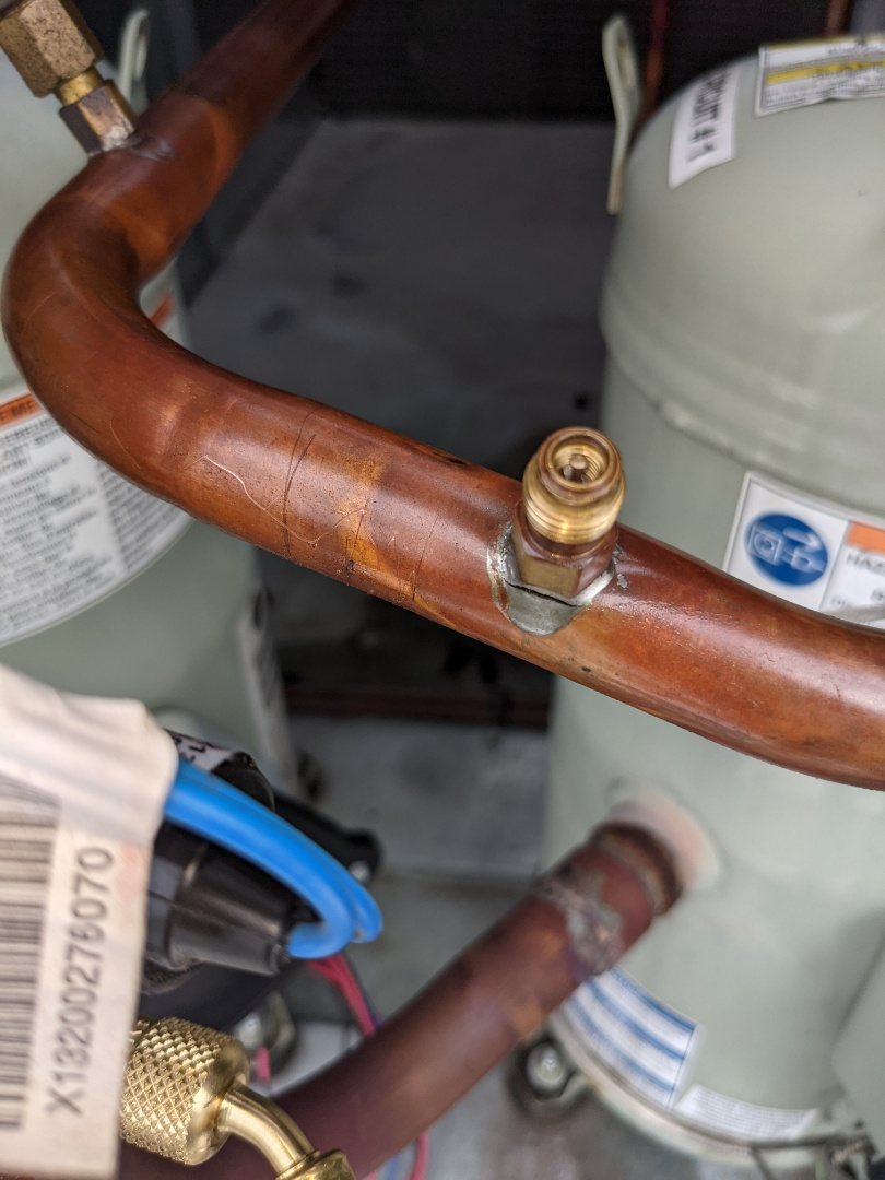 Towson, MD - Charlie repaired a leaking refrigerant line on a commercial Trane Rooftop unit.