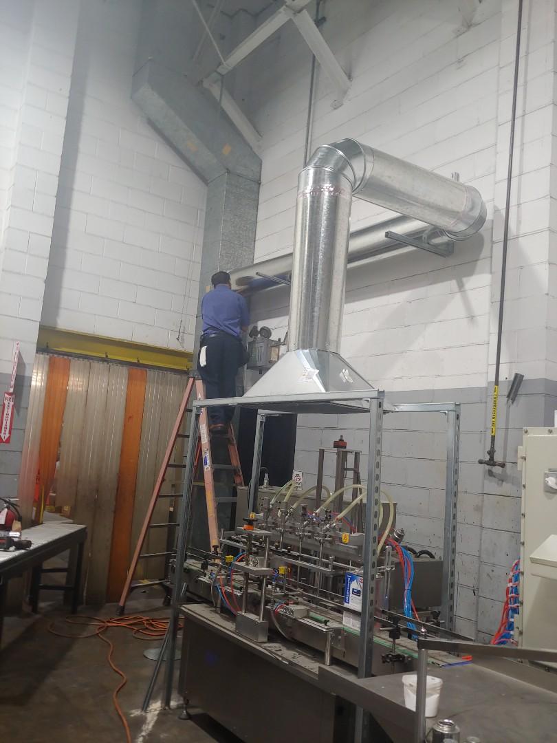 Houston, TX - Installing vent hoods for the PVC glue station.