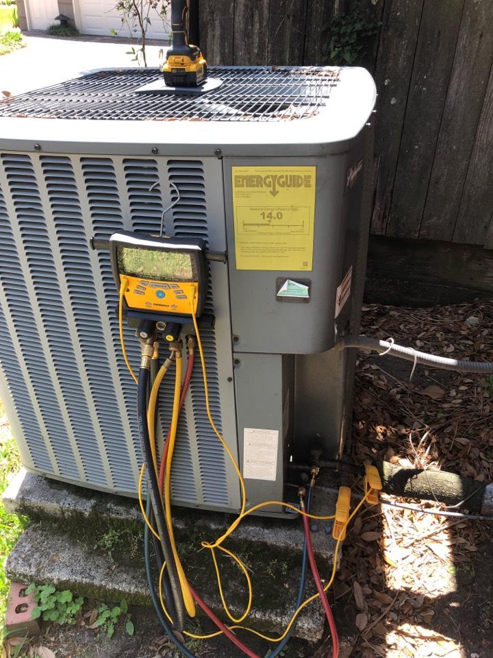 Houston, TX - Performing AC maintenance on system