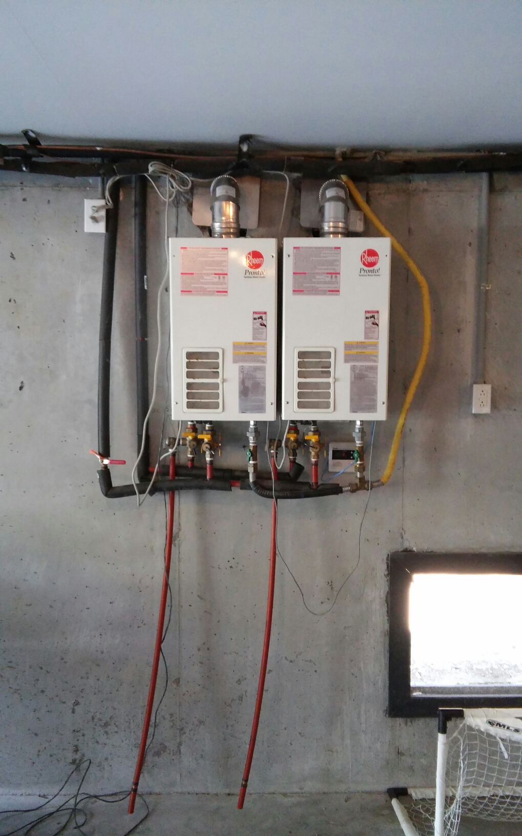 Isle Of Palms, SC - Two rheem tankless water heaters not heating water. Replaced with two navien tankless water heaters.