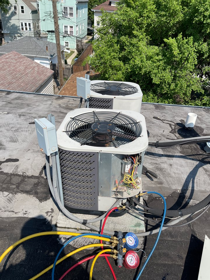 Chicago, IL - Ac check on rooftop.