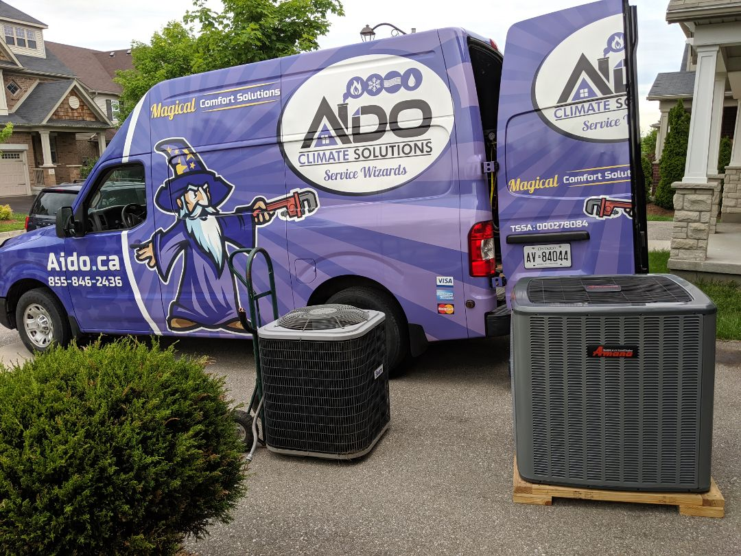 Guelph, ON - Air conditioner replacement. Amana 2-Stage 16 SEER air conditioner replacing an old Sears air conditioner with a failed compressor.