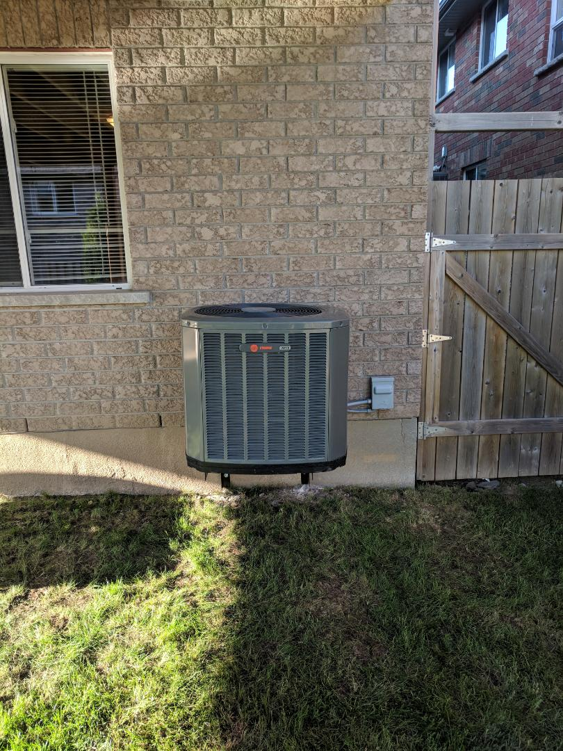 Guelph, ON - Install Call to Relocate a Trane Air Conditioner from the side of the house to the back of the house.