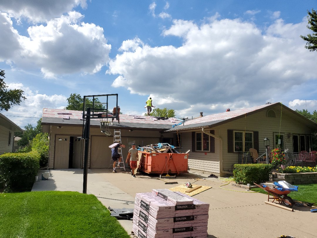 St. Cloud, MN - Hail restoration of roof and gutters. New Owens Corning Duration shingles Desert Tan