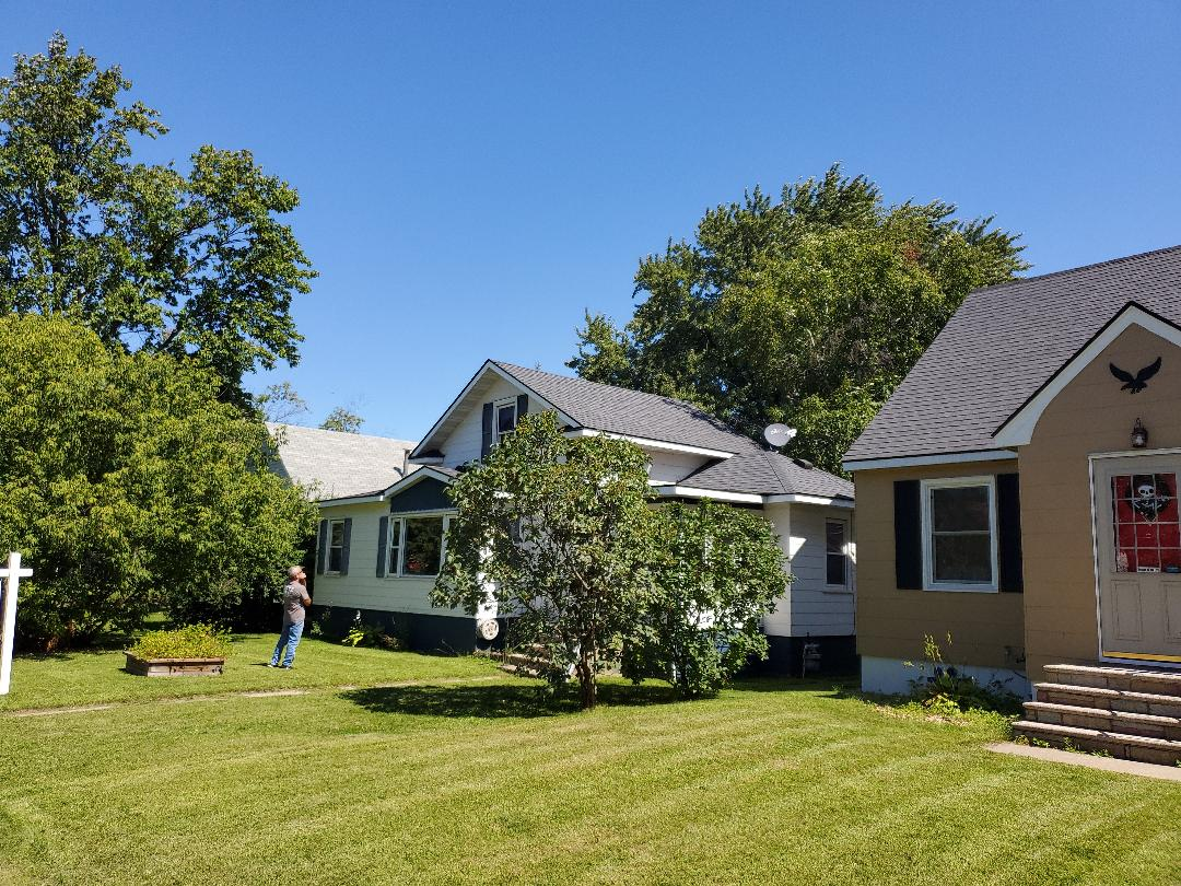 St. Cloud, MN - Storm damaged roof. Scheduled to be reroofed in 3 weeks with Owens Corning Duration asphalt shingles.