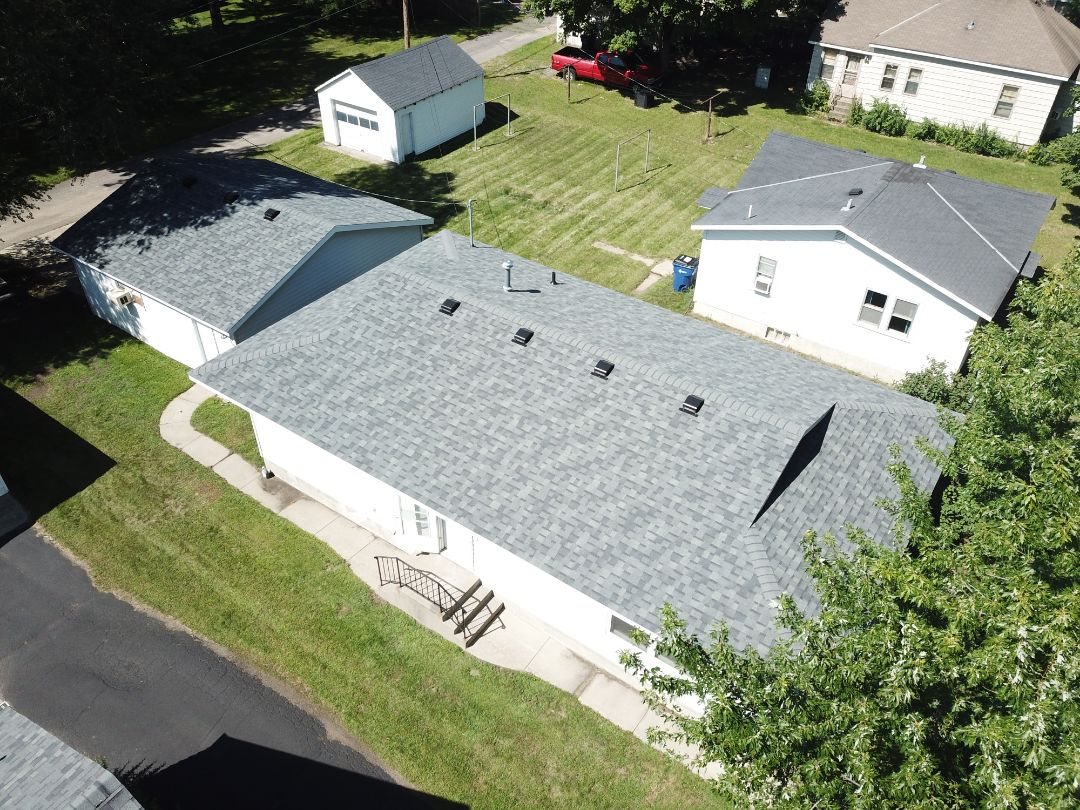 St. Cloud, MN - Asphalt shingles on this roofing project. 1 day job from Oberg Roofing & Remodeling Inc. House and Garage.