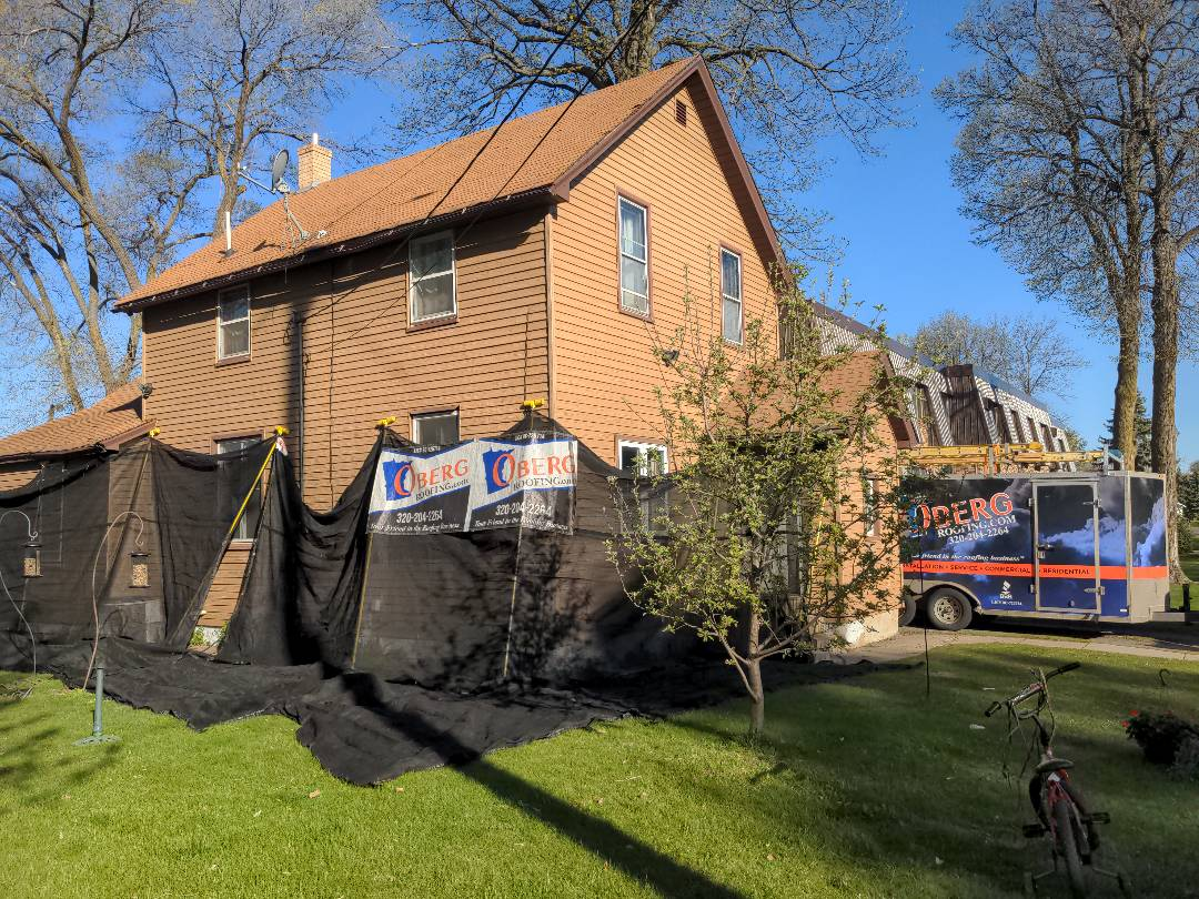 St. Cloud, MN - It's a steep 2 layer roof tear off but no worries the catchall will protect the siding and make clean up way easier!