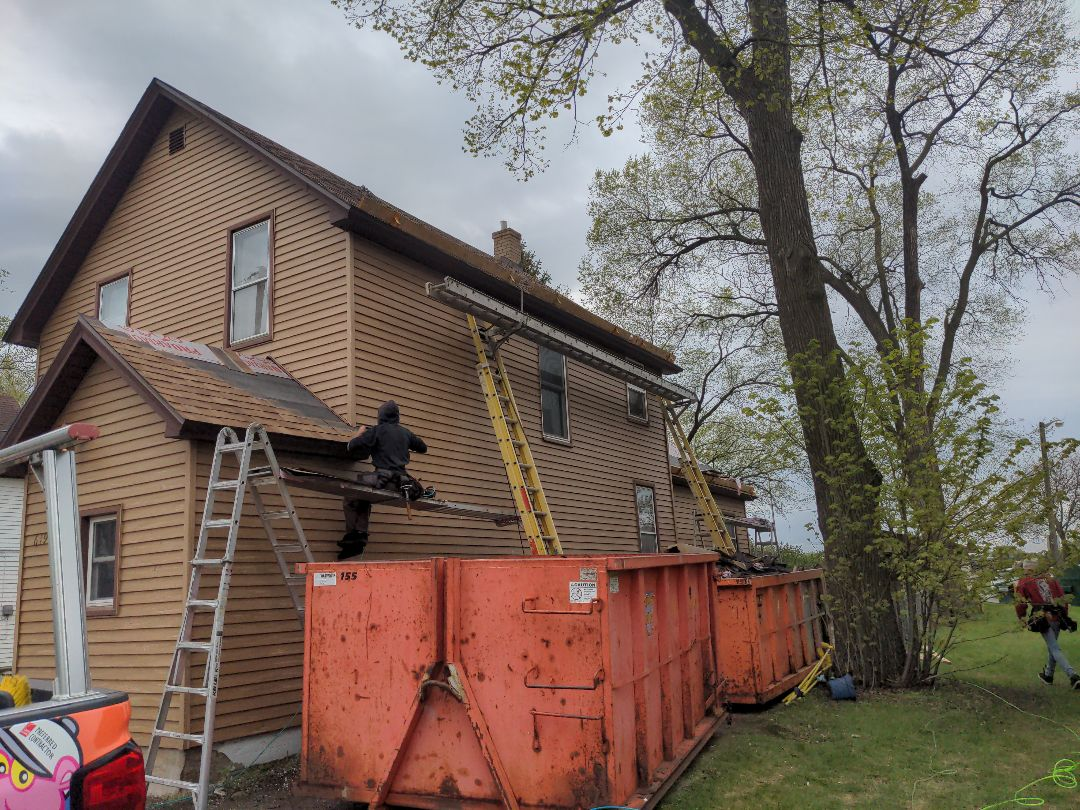 St. Cloud, MN - It was a rainy morning but we should still get done today. Way to power through this 3 layer tearoff and resheet guys! It looks great!