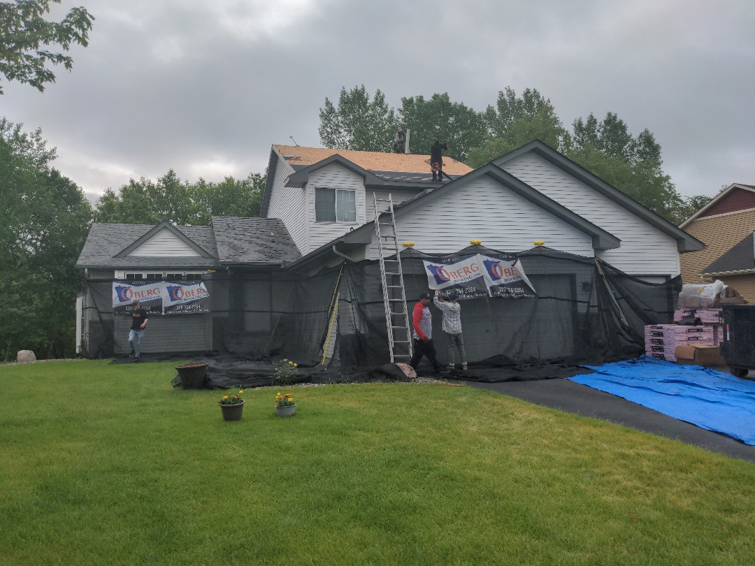 Otsego, MN - We make sure your siding is protected when we tear off your roof the catchall also makes cleanup a snap!