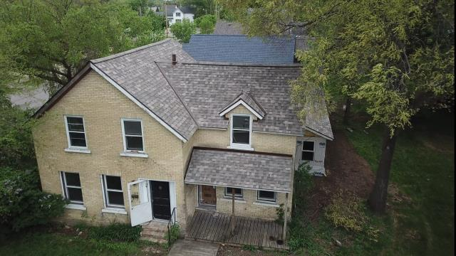 St. Cloud, MN - Beautiful new roof for a great customer. Owens Corning Shingle color of the year Sand Dune in the Designer series.