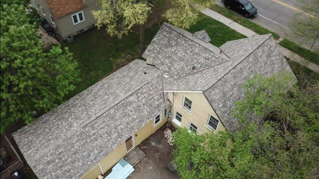 St. Cloud, MN - Wow what a transformation to this great shingle color from Owens Corning Designer series Sand Dune. Also the color of the year! Thanks Pat for the work we greatly appreciate it!