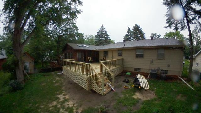 Crystal, MN - New deck 18x20' with nice aluminum spindles and lattice skirting to keep the critters out.