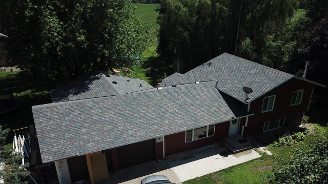 Avon, MN - Great customers! We hooked them up with Duration Colonial Slate shingles after hail destroyed their roof.