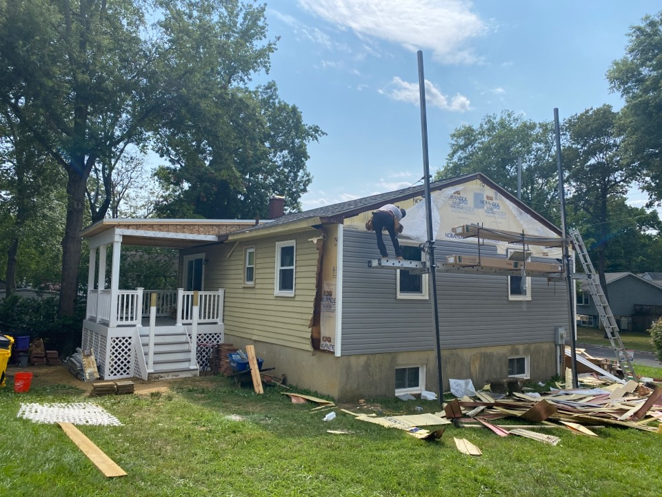 Edgewater, MD - Siding and deck job being completed
