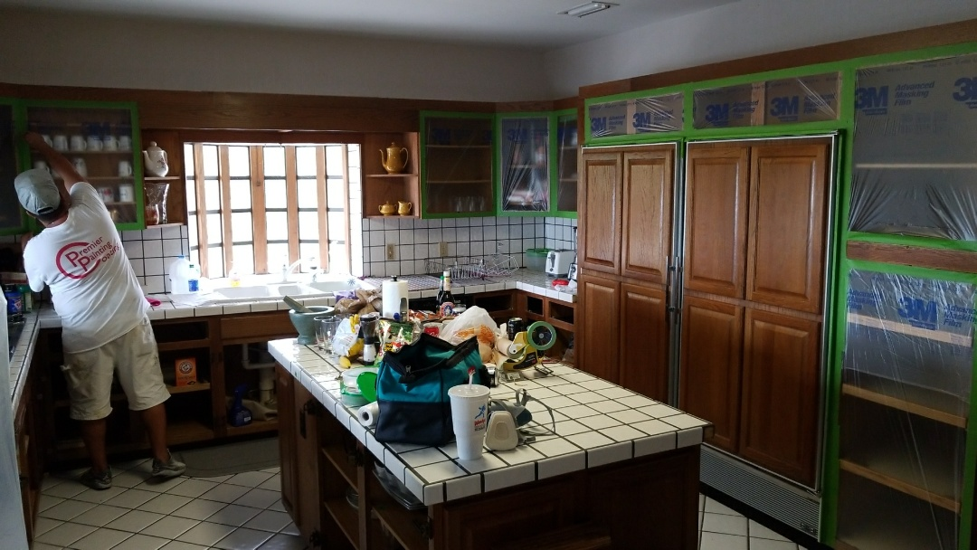 Kitchen cabinets and dining room painting. Protecting all areas not receiving paint. Removing all cabinet doors and drawer faces. Sand and de-gloss. Oil prime and apply 2 coats in Sherwin Williams pro classic finish paint. Reinstall doors and drawers. Clean up and haul away waste