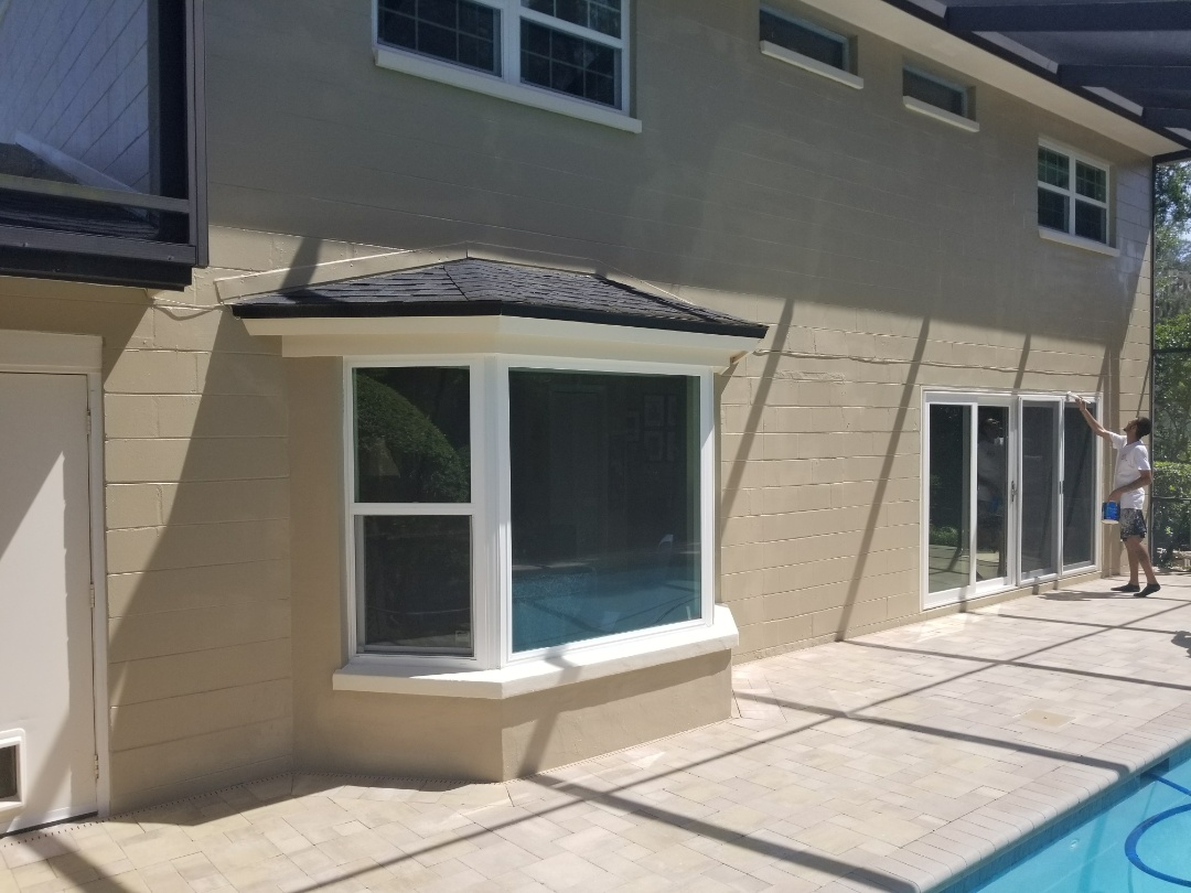 Tampa, FL - Scrape exterior wall. Fill all holes and cracks. Repaint wall with Sherwin Williams resilience.  Sealed all pavers. Clean up and haul away trash