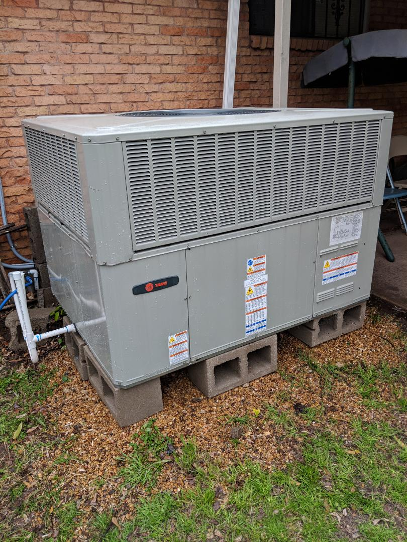 Dallas, TX - Cooling inspection and seasonal spring tuneup. Checked and serviced Trane air conditioning system.