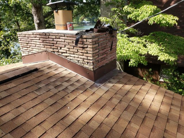 Chapin, SC - Tear out existing shingles and flashing from around brick chimney. Tear out and replace damaged pipe boot flashing. Check for rotted/damaged roof decking, see disclaimer below. Replace shingles around pipe boot flashing as needed.