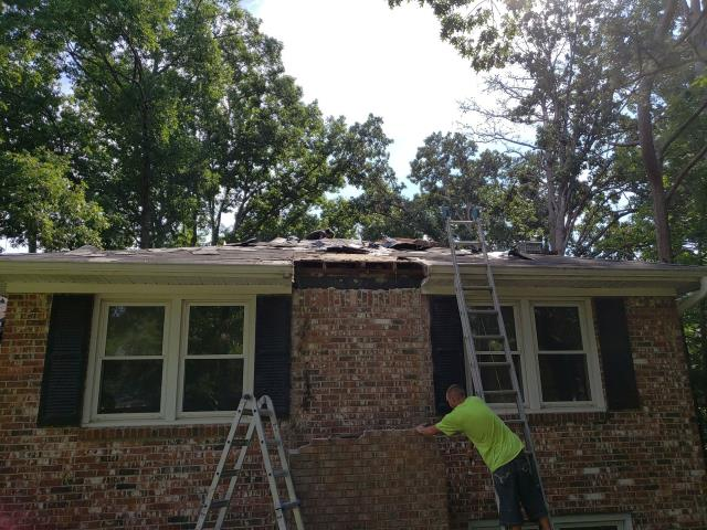 West Columbia, SC - removed gutter from house and installed new white gutters around the outside house. fixed the chimney on residential home in columbia sc