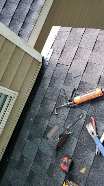 Columbia, SC - Repair shingles and flashing on the side of his residential home in columbia south carolina