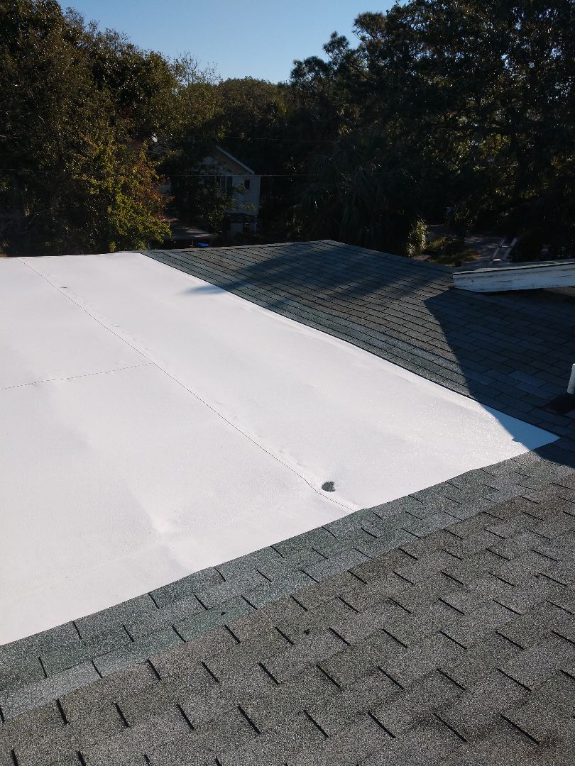 Folly Beach, SC - New TPO roof installed on a residential flat area hover system
