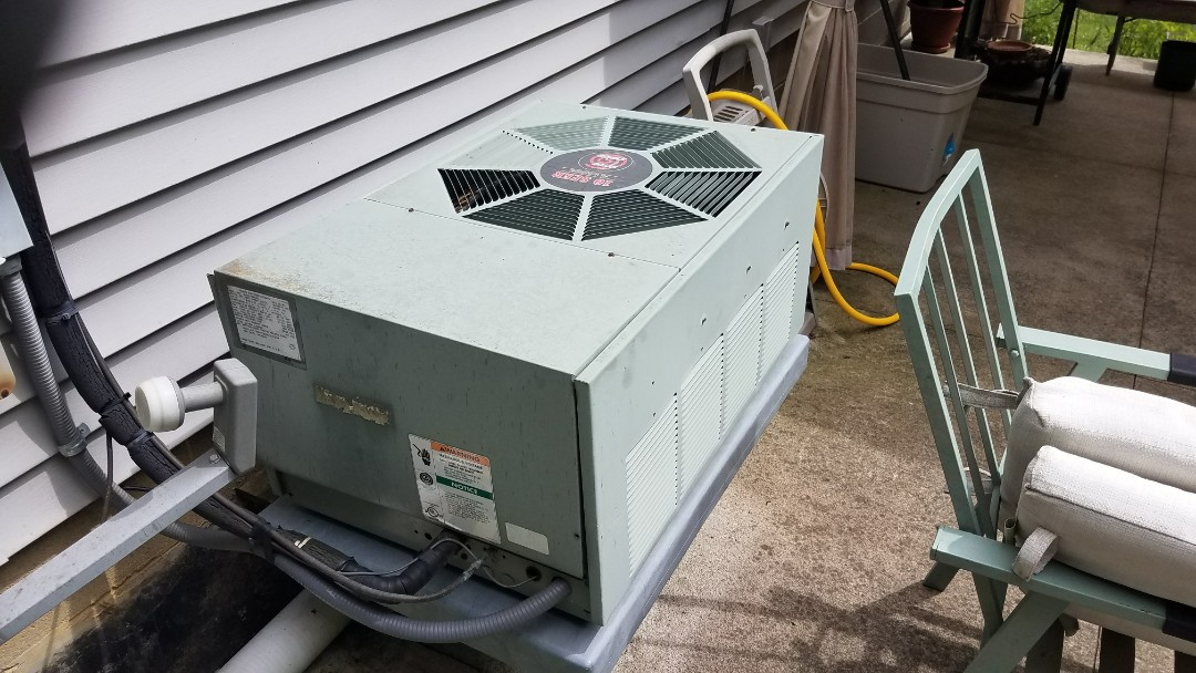 Working on a theme air conditioner that has no cooling in Massillon ohio 4464y
