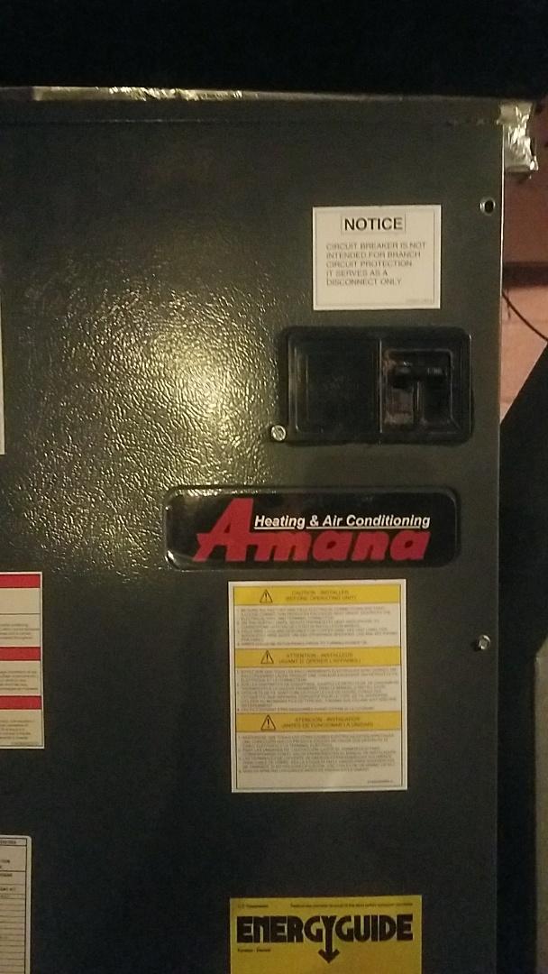 Working on Amana air handler in Berlin center