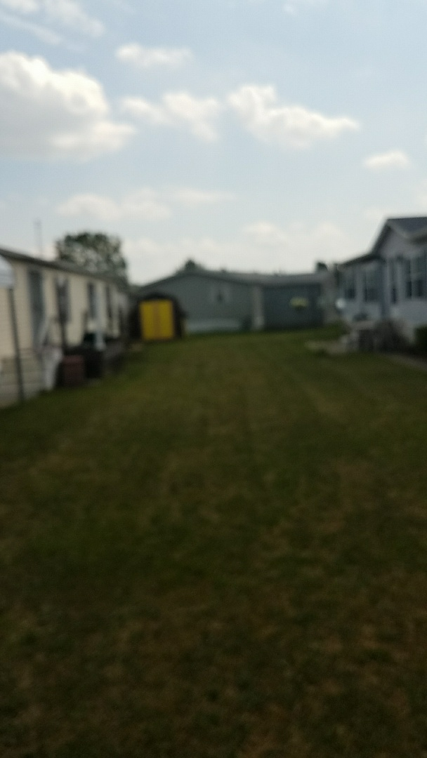 Working on a mobile home air conditioner in Camelot village Streetsboro ohio 44241.  30 year old r-22 system unit is up and working at this time