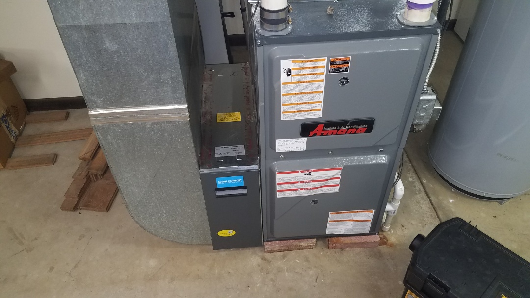 Repairing an Amana gas furnace that has a wasp nest in the vent pipe